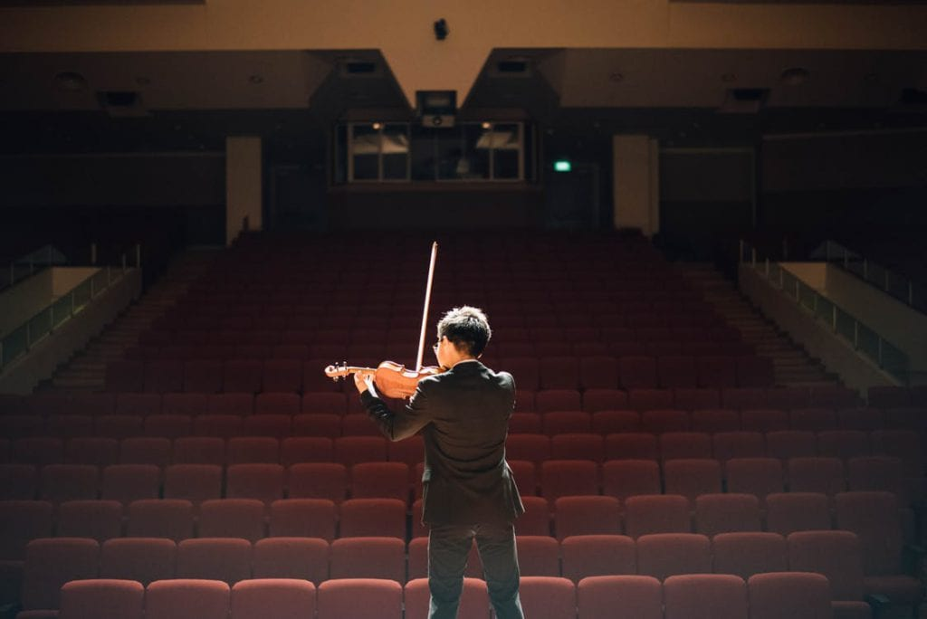guy playing violin