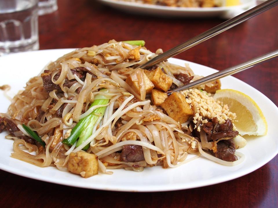 thai food with chopsticks