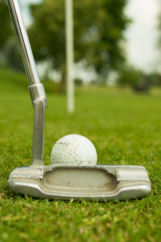 golfing on field